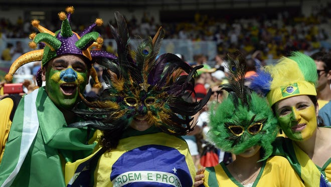 Fans cheer during the quarterfinal match between Germany and Brazil in the 2014 World Cup at Estadio Do Maracana.