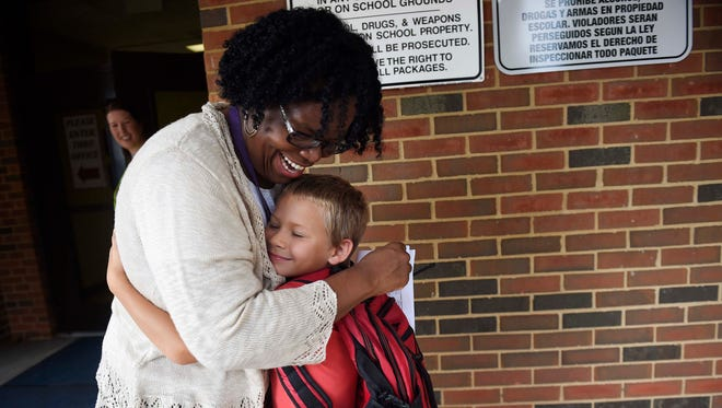 Principal Cheryl Robey greets first-grader Gary Swafford on the first day of school at Liberty Elementary in 2016. The Franklin school is the first school in Williamson County to participate in a statewide training on meeting the needs of children who have experienced significant trauma.