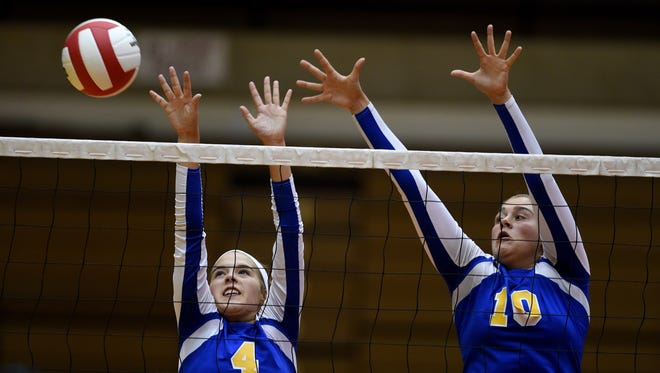Lincoln's Rachel Merida, left, and Kylei Klein jump to block against Richmond Tuesday, Sept. 13, 2016 during a volleyball match at the Tiernan Center in Richmond.