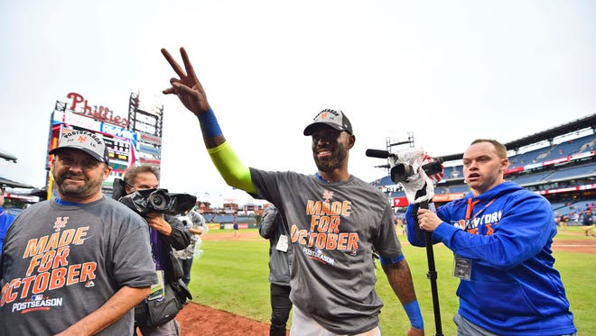 New York Mets third baseman Jose Reyes (center) walks off the field in Philadelphia on Saturday after clinching a wild-card playoff berth by beating the Phillies. Reyes, signed to help fill holes in the lineup left by injuries, has given the team a jolt.