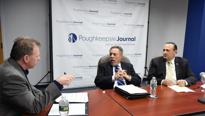 From left, John Penney, Poughkeepsie Journal Opinion and Engagement Editor speaks with New York State Assembly Conservative candidate William Banuchi and Assemblyman Frank Skartados during Friday's Editorial Board meeting. Skartados and Banuchi are running for the 104th Assembly District seat which includes Newburgh, Beacon and Poughkeepsie as well as the towns of Lloyd and Marlborough.