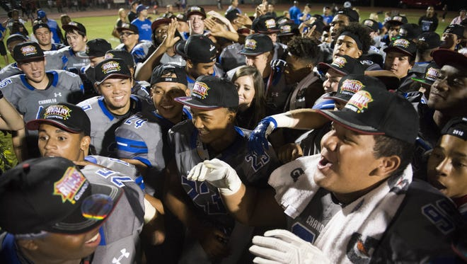 Chandler High School's football team celebrates on the field after the team defeated Brophy College Prep 56-7 at Chandler High School on Friday, Oct. 21, 2016.