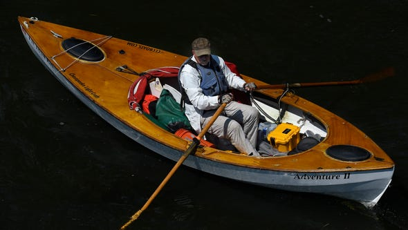 John Guider makes his way down the Holston River in