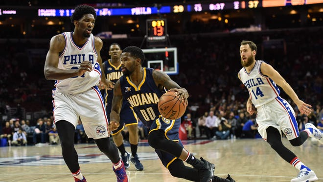 Nov 11, 2016; Philadelphia, PA, USA; Indiana Pacers guard Aaron Brooks (00) drives toward the net as Philadelphia 76ers center Joel Embiid (21) defends during the second quarter of the game at the Wells Fargo Center.