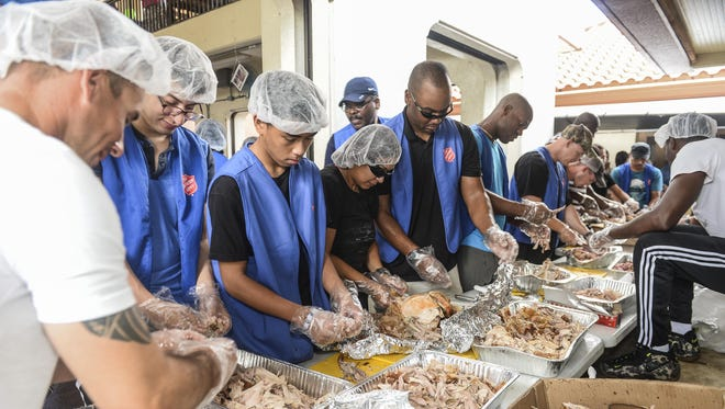 Volunteers work quickly to debone turkeys to feed the less fortunate during The Salvation Army's annual Thanksgiving feast at the Chamorro Village in Hagåtña on Nov. 26, 2015.