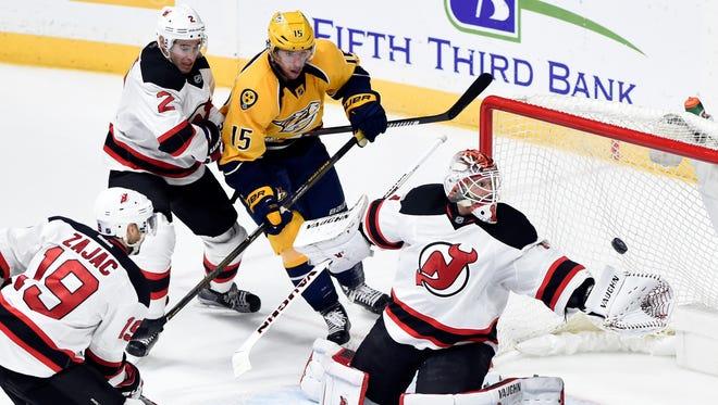 New Jersey Devils goalie Keith Kinkaid (1) gloves a shot against the Nashville Predators on Saturday.