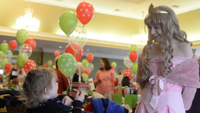 Ruby Diggs entertains a royal guest during Bows & BallCaps presents Breakfast with Santa on Dec. 3, 2016 in Hendersonville at the Bluegrass Yacht & Country Club.