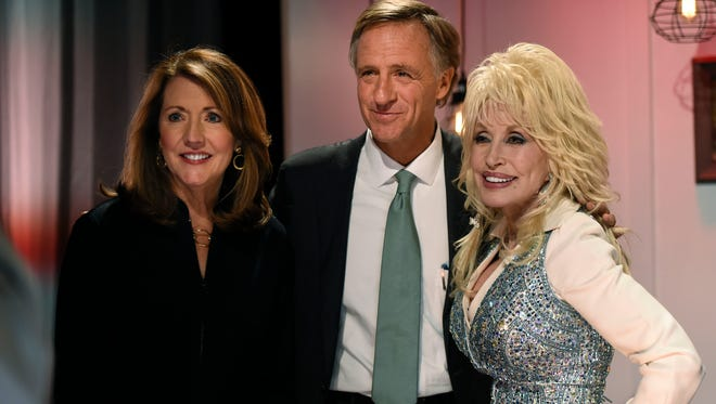 First Lady Crissy Haslam and Governor Bill Haslam with pose for a picture with Dolly Parton during the Smoky Mountains Rise telethon Tuesday, Dec. 13, 2016, in Nashville, Tenn.