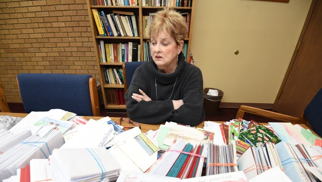 Judy Fagan, education specialist for Health Resources of Arkansas, discusses the thousands of Christmas cards Baxter County school children wrote to veterans.