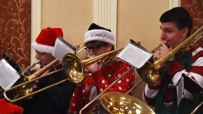Members of the Arlington High School Brass Choir play at the Dutchess County Regional Chamber of Commerce's December contact breakfast. From left to right: Alex Besio, 17, Thomas Banney, 17, and Sean Foley, 17.