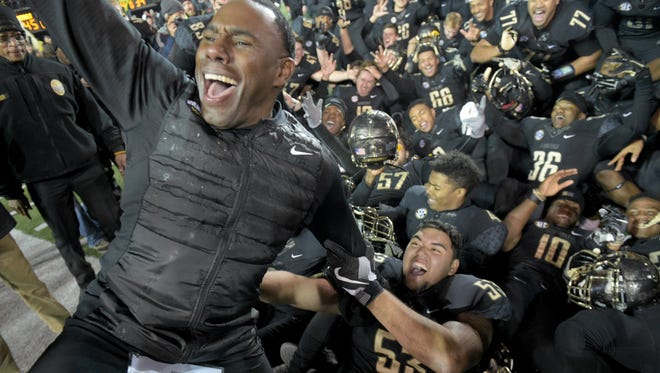Vanderbilt coach Derek Mason celebrates his team's 45-34 win over Tennessee on Saturday, Nov. 26, 2016 at Vanderbilt Stadium. The win allowed Vanderbilt to go to a bowl game for the first time under Mason.