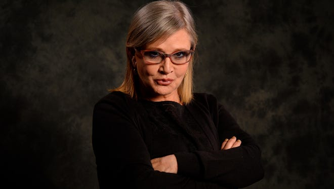 Carrie Fisher poses for a photo while promoting 'Star Wars: The Force Awakens.'