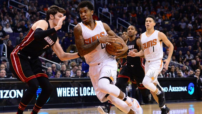 Jan 3, 2017: Phoenix Suns forward Marquese Chriss (0) moves the ball in front of Miami Heat forward Luke Babbitt (5) in the first half of the NBA game at Talking Stick Resort Arena.
