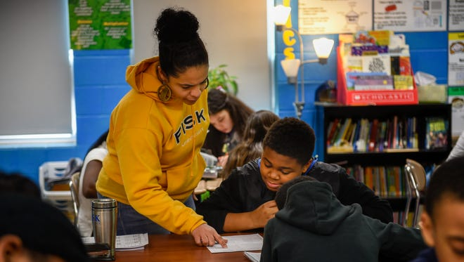 Fifth-grade teacher Anna Hoskins instructs Josh Shanks during a test Feb. 10, 2017, at I.T. Creswell Middle Prep in Nashville. Nashville is the only large district in Tennessee to predominantly serve fifth-grade students in middle school.