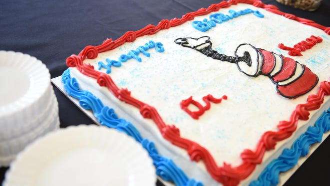 A cake waits to be sliced during a party to commemorate the 112th birthday of Dr. Seuss at Maryville College on March 10, 2016.