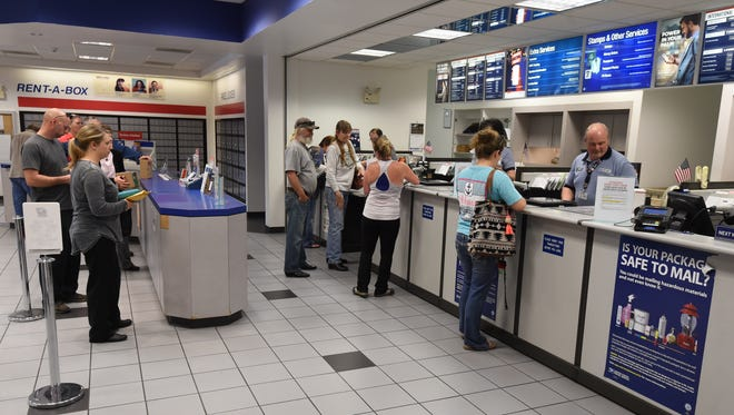 Patrons at the Mountain Home Post Office wait in line Tuesday. On Saturday, those wishing to apply for a passport can do so with an appointment.