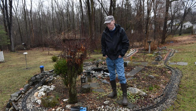 Thomas Murphy stands in the midst of his garden railway in the backyard of his Hyde Park home.