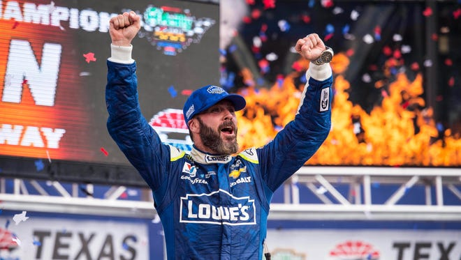 Jimmie Johnson celebrates after winning the O'Reilly Auto Parts 500 at Texas Motor Speedway.
