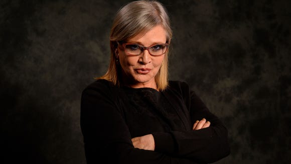 Carrie Fisher poses for USA TODAY before the premiere