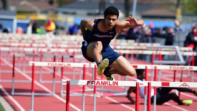 Livonia Franklin's Marcus Martin kicks it in overdrive during the shuttle hurdles.