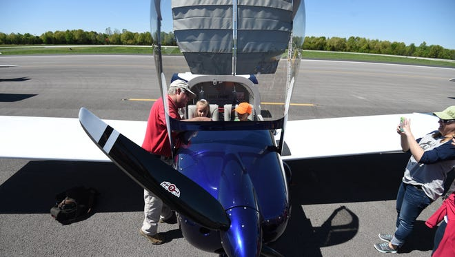 Tecumseh based pilot Daniel Israel shows Twin Lakes Area home school children his Vans RV12 aircraft Monday. Big Air sponsored the event to help students learn about aviation.