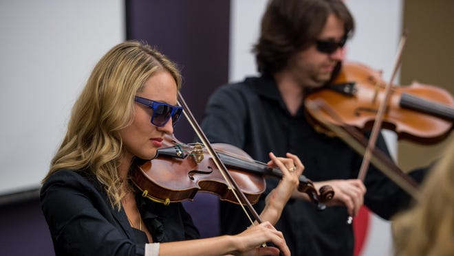 Iya Tsyrkot and Emil Ivanov from the Acadiana Symphony Orchestra perform during the Acadiana Roots series at the Daily Advertiser.