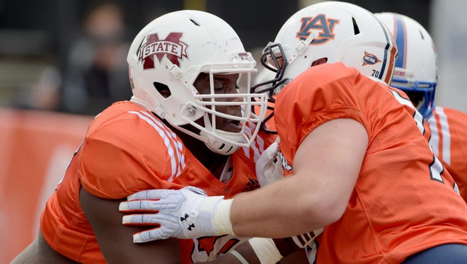 Offensive tackle Justin Senior of Mississippi State (left) works against Auburn's Robert Leff during a Senior Bowl practice in January.