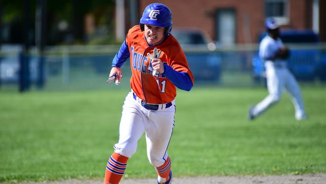 Digging around the bases Wednesday is Garden City's Avery Emerson (11).