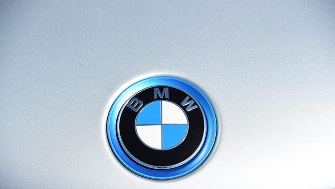 "A BMW logo, on an electric BMW car is seen on display in front of the  Berlin Congress Centre during a two-day national conference on ""Electro-mobility"" or electric vehicles, in Berlin June 15, 2015."