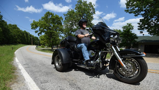 Bob Buschbacher rides his Harley Davidson trike through his Tracy neighborhood. May is Motorcycle Awareness Month as riders who've had their motorcycles in storage through the cold months wheel them out and hit the road again.