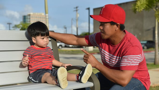 Lincoln Batangan, 19 months, is scolded by his father Lawrence at Skinner Plaza in Hagåtña on May 15, 2017.