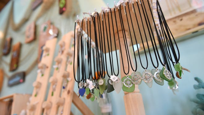 Sea glass accessories are displayed in Shining Shores Sea Glass shop at Chamorro Village on May 23, 2017.