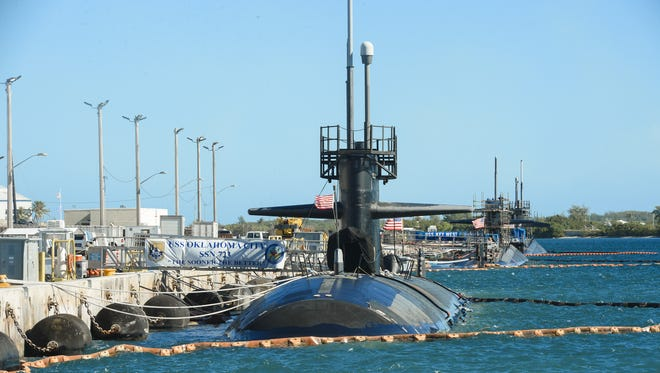 U.S. Navy fast-attack submarines, from left, U.S.S. Oklahoma City, U.S.S. Key West and the U.S.S. Chicago can be seen docked at Naval Base Guam on Jan. 11, 2016.