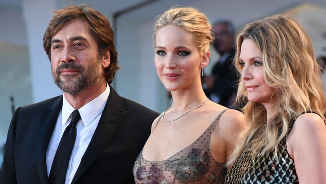 Javier Bardem, left, Jennifer Lawrence and Michelle Pfeiffer star in 'Mother!' The movie premiered Tuesday at Venice Film Festival.