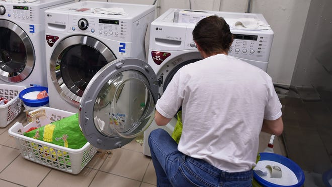Scientists say washing machines release large amounts of plastic microfibers into the water supply.