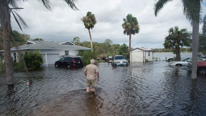 """""""This is enough to shake your faith,"""" said Lon Parsons, of Fort Pierce, after 10 inches of rain flooded his property during Hurricane Irma, seen Monday on Edwards Road in Fort Pierce.   Parsons, his wife Anna Parsons, and their three dogs rode out the storm as their yard and garage filled with water. """"I swear it was an act of God,"""" Lon Parsons said.""""I just feel blessed that we're not like Harvey."""""""