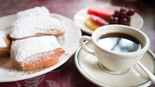 Beignets are served at Lucile?s with a pile of powdered sugar. The fried dough is a typical breakfast dish in New Orleans. Beignets are served at Lucile's with a pile of powdered sugar. The fried dough is a typical breakfast dish in New Orleans.