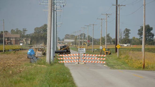 Crews work Thursday on Round Barn Road in Richmond. The project is being paid for in part by money from the state's Community Crossings program.