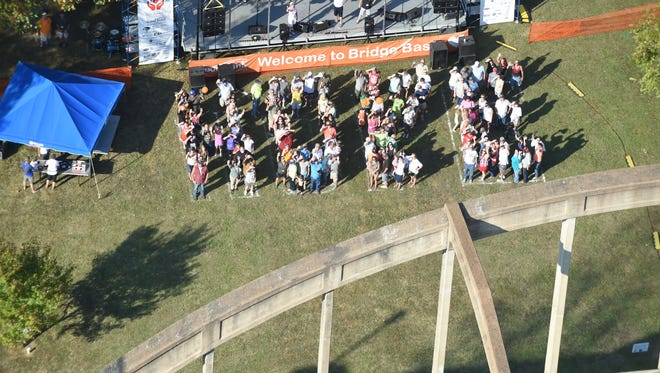 """A crowd of people spell out the word """"hope"""" Saturday during the seventh Annual Bridge Bash."""