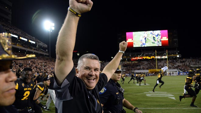 Arizona State Sun Devils head coach Todd Graham celebrates after the second half against the Washington Huskies at Sun Devil Stadium.