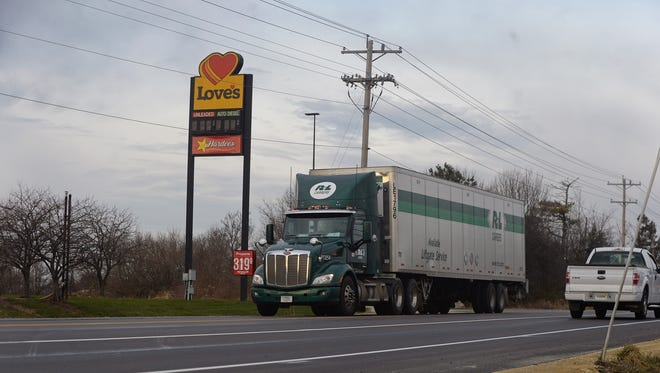 A semi pulls out of the entrance of Love's Travel Stop on U.S. 35 just north of the Interstate 70 interchange in Richmond.