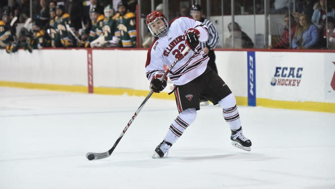 Defenseman Ben Finkelstein, a South Burlington native, unleashes a shot while playing for the St. Lawrence men's hockey team.
