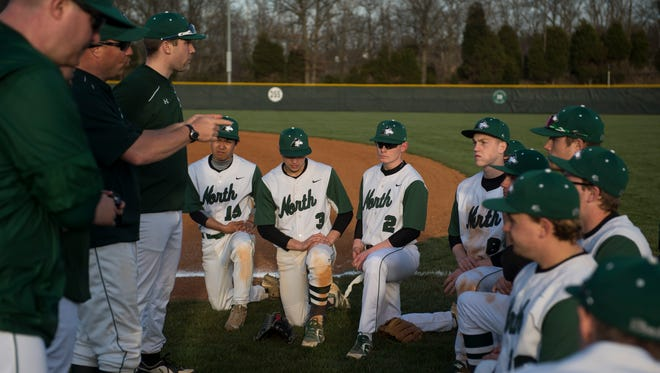 North coaches talk to their team after playing Bosse at North High School on Wednesday, April 11, 2018. North defeated Bosse 14-0.
