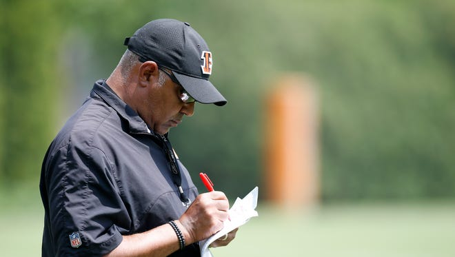Cincinnati Bengals head coach Marvin Lewis takes notes during the first day of OTAs at the Cincinnati Bengals practice facility in downtown Cincinnati on Tuesday, May 22, 2018.