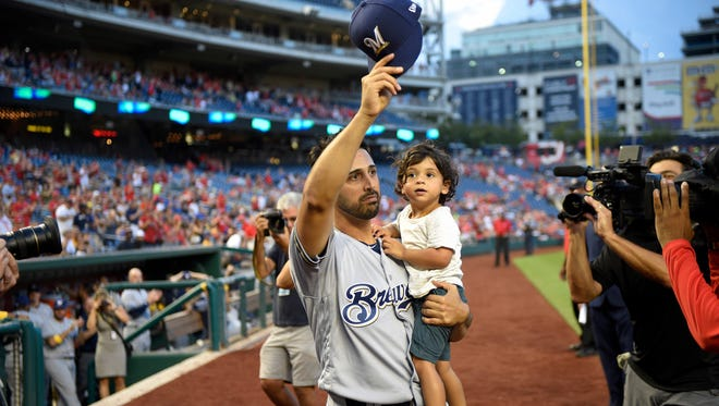 New Brewers pitcher Gio Gonzalez waves his cap to the crowd before the game Saturday against the Nationals. Gonzalez was traded Friday to the Brewers from Washington.