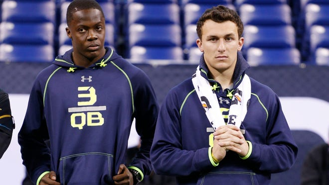 Louisville quarterback Teddy Bridgewater, left, and Texas A&M quarterback Johnny Manziel look on during the 2014 NFL combine at Lucas Oil Stadium in February.