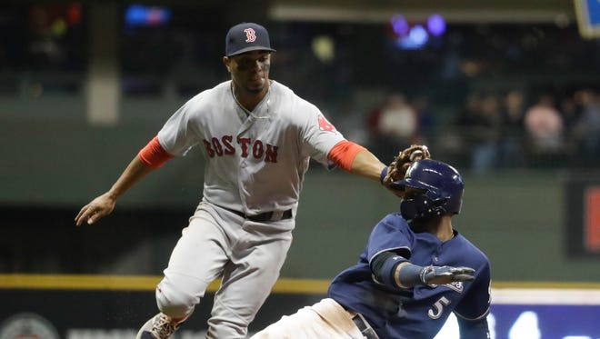 Jonathan Villar gets caught in a rundown on Tuesday night and is tagged out by Xander Bogaerts. Villar was out of the starting lineup Wednesday.