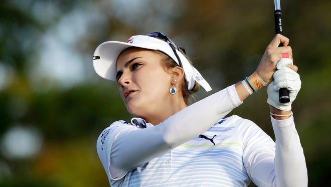 Lexi Thompson watches her drive on the 12th hole during the first round of the Indy Women in Tech Championship golf tournament, Thursday, Sept. 7, 2017, in Indianapolis. (AP Photo/Darron Cummings)