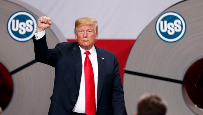 President Donald Trump acknowledges the audience after speaking at the United States Steel Granite City Works plant in Granite City, Ill.
