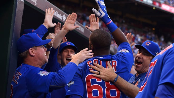 Jorge Soler is congratulated for hitting a two-run home run in the fifth inning.